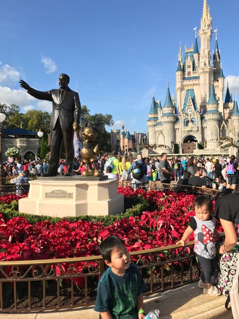 Walt Disney and Mickey in front of Cinderella Castle at Magic Kingdom
