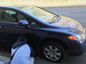 My husband was fixing flat tire on road at New York.